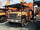Altec LRV-55, Over-Center Bucket Truck, mounted behind cab on 2002 GMC C7500 Chipper Dump Truck,