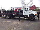 Elliott ECE-3-70-H, Telescopic Non-Insulated Platform Lift mounted behind cab on 2001 International 4900 Flatbed/Utility Truck