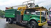 Lift-All LAOC-55-1S, Over-Center Bucket Truck mounted behind cab on 2001 International 4700 Chipper Dump Truck