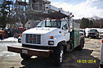 Posi Plus 800-40, Telescopic Non-Insulated Cable Placing Bucket Truck, rear mounted on, 2002 GMC C7500 Flatbed/Utility Truck