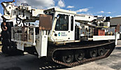 Telelect 6000, Digger Derrick rear mounted on 2001 Laurin Inc. Soft Track ST-15T All-Terrain Track Machine