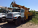 Telelect Commander 4045, Digger Derrick rear mounted on 2000 International 4800 4x4 Flatbed/Utility Truck