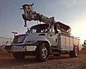 Telelect Commander 4047, Digger Derrick, rear mounted on, 2006 International 4300 Utility Truck