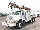 Telelect Commander 5050, Digger Derrick rear mounted on 2000 International 4900 T/A Flatbed/Utility Truck