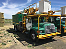 Terex XT55, Over-Center Bucket Truck mounted behind cab on 1999 Ford F800 Chipper Dump Truck