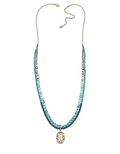 SWAROVSKI Gold Tone Pendant and Multi Blue Bead Necklace