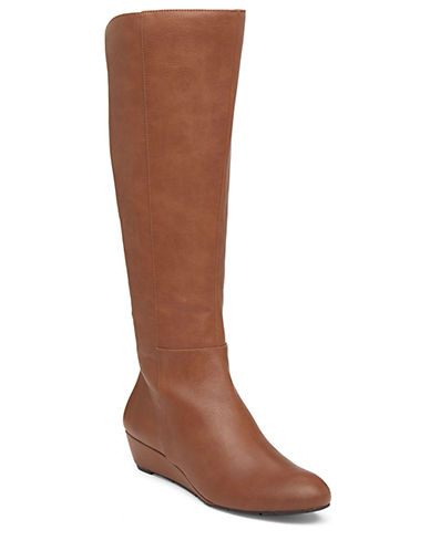 Buy Bafford Faux Leather and Elastic Knee-High Wedge Boots by Jessica Simpson online
