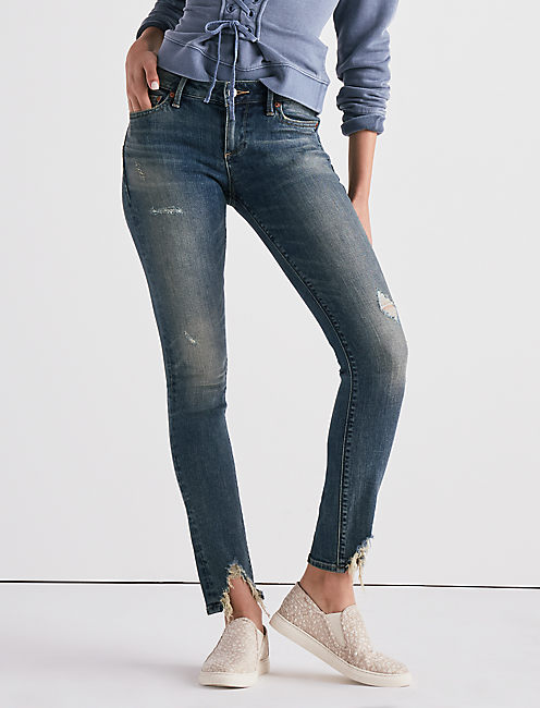 LOLITA MID RISE SKINNY JEAN WITH FRONT CHEW,