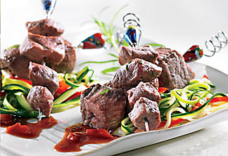 Beef and lamb skewers marinated in red wine
