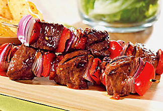 Beef tenderloin and chorizo brochettes with plum and coriander