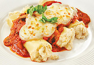 Two-cheese cannelloni and tomato sauce with mushrooms