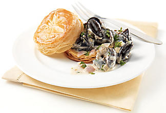 Escargot and goat cheese puff pastries