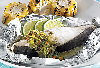 Barbecued halibut in foil with salted herbs