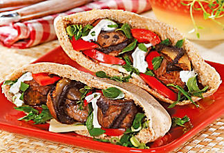 Beef pita garnished with fresh herb salad