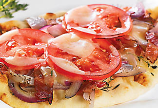 Barbecued pizza with onions and tomatoes