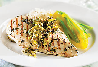 Grilled chicken breast with olive and herb marinade