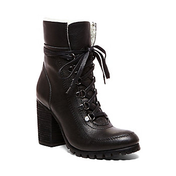Combat Boots for Women. Take your look in a bold new direction with combat boots for women. Indicated by signature features like a lace-up front and a lug sole, combat boots are a look that has grown in popularity.