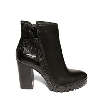 MARIAH is a block heeled ankle bootie with functional zippers down either side. Works wonders with denim skinnies and a long sleeved shirt with a chic topknot. Leather upper material Man-made lining Man-made sole 4 inch heel height .5 inch platform 10 inch shaft circumference 4.25 inch shaft height