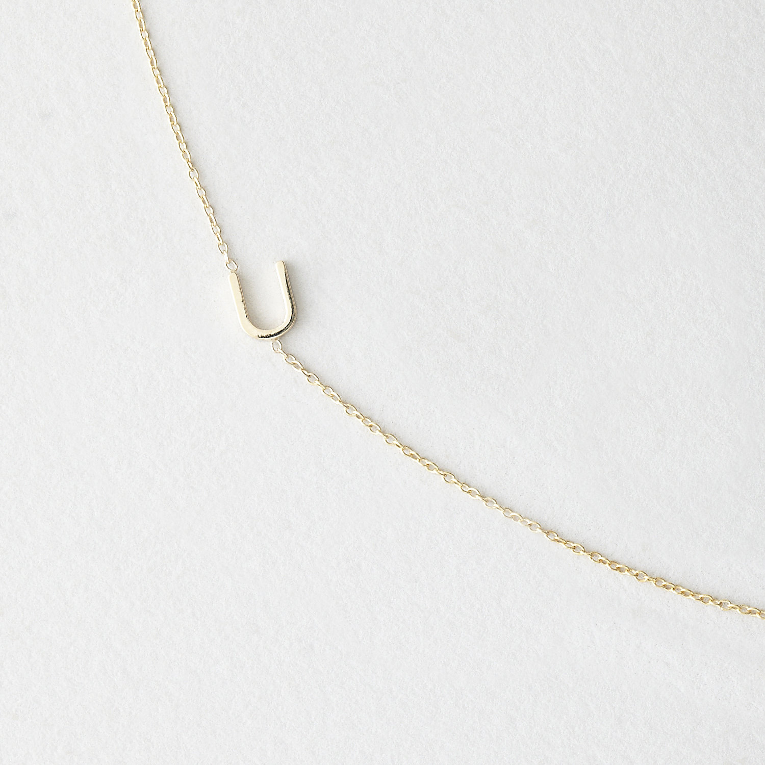 ASYMMETRICAL MINI LETTER NECKLACE - U
