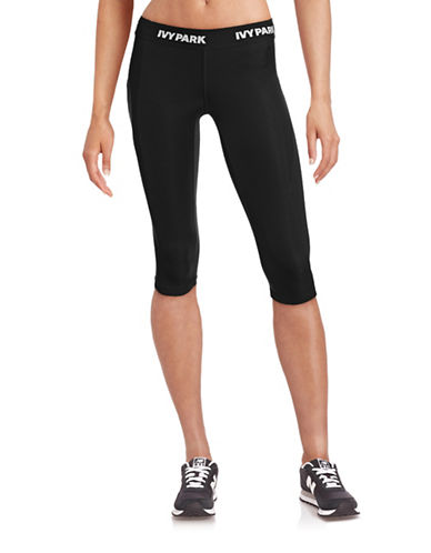 Ivy Park I - Low-Rise Logo Capri Leggings-BLACK-Medium 88384481_BLACK_Medium