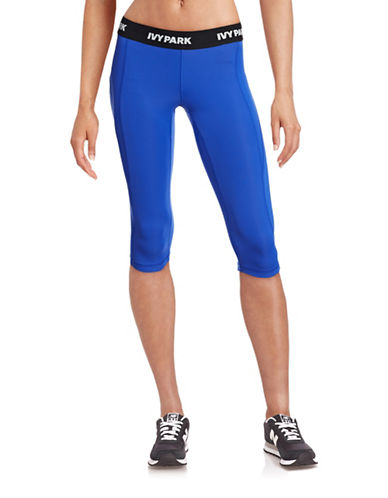 Ivy Park I - Low-Rise Logo Capri Leggings-BLUE-X-Small 88384488_BLUE_X-Small