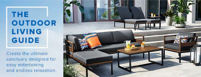 A Modern Outdoor Seating Set Of Dark Wood Tables With Cushioned Loungers, A  Sofa And