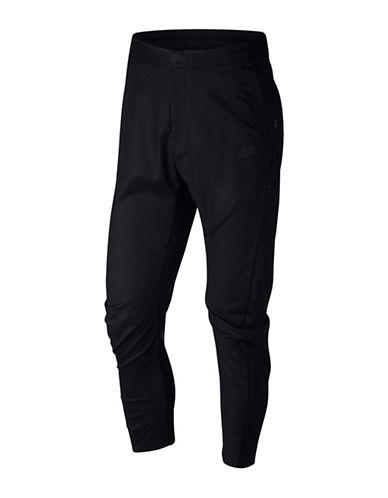 Nike Pantalon d'entraînement en tissu contrecollé Sportswear 89848101