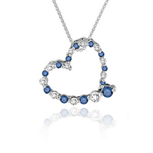 Eye Catching 1/4 Carat Blue Diamond Heart Pendant