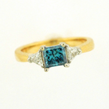 Alluring Blue Diamond Engagement Ring