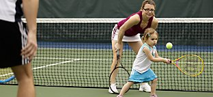 Family Playing Tennis at Sports Core