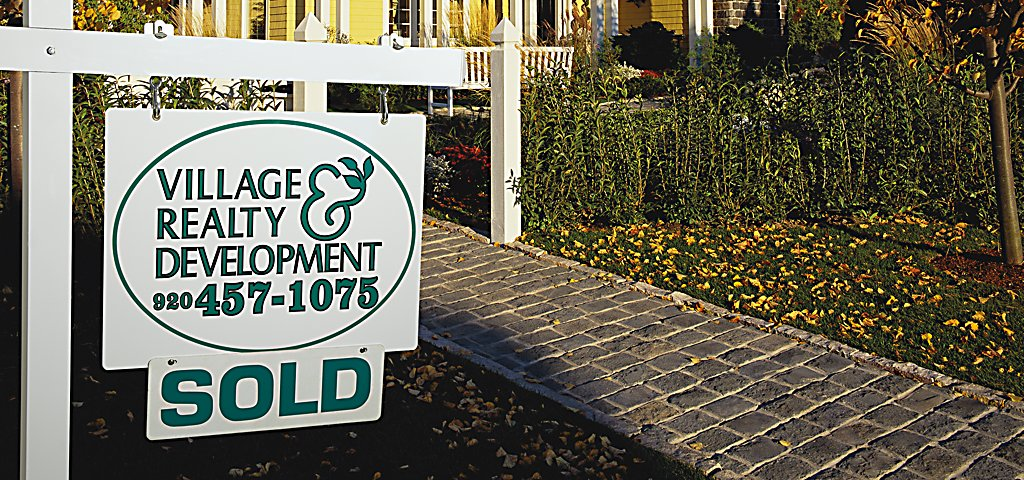 Village Realty & Development SOLD Sign