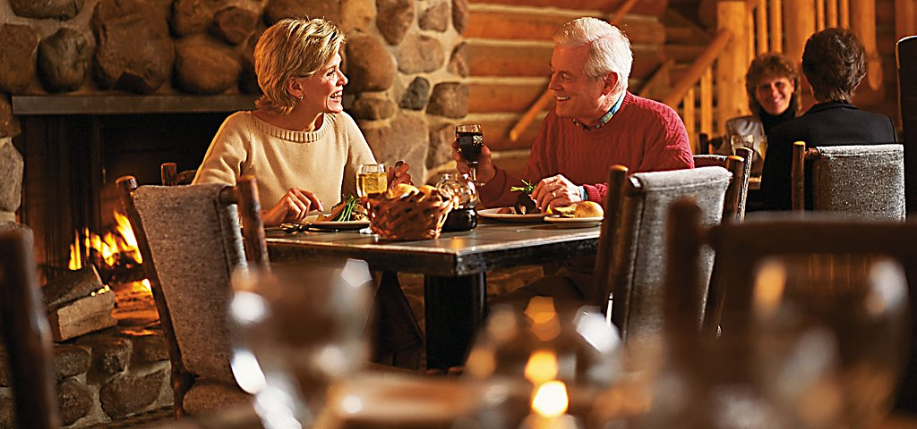 Blackwolf Run Restaurant Couple Dining in Front of Fireplace