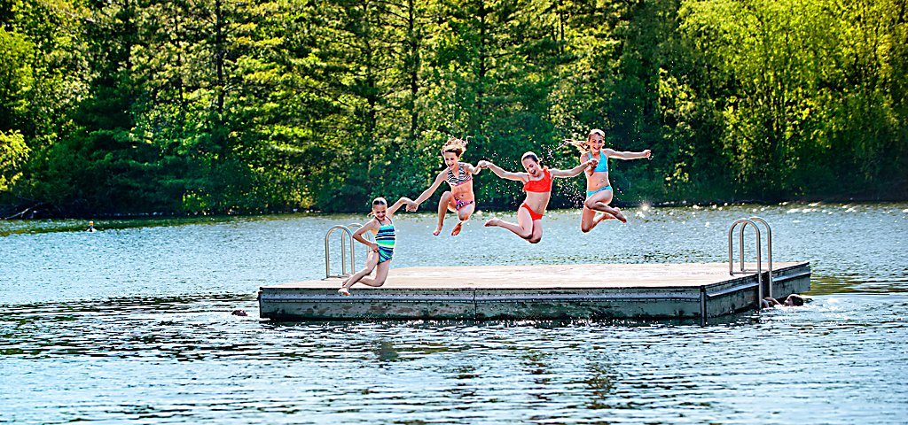 Kids Jumping Off of Raft in Lake at Sports Core