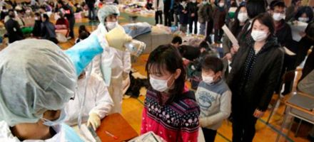 Japanese citizens receive a radiation exposure check following the 2011 Tōhoku earthquake and tsunami