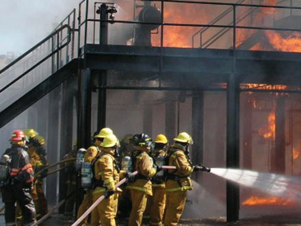 Firefighters battle a blazing fire.