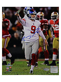 Lawrence Tynes Celebrating vs. San Francisco Vertical 8x10 Photo