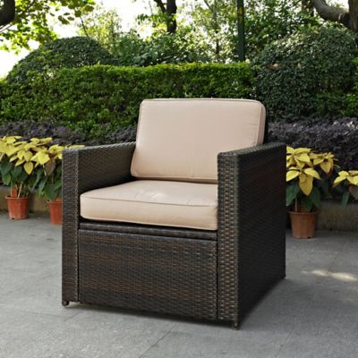 Crosley Palm Harbor Wicker Arm Chair In Brown With Sand Cushion
