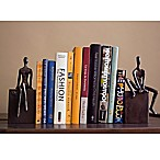 Danya B. Man and Woman Sitting on a Block Bookend Set in Brown