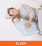 ERGObaby - Sleep; image of swaddled child and mother