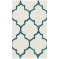 Safavieh Kids Shag 2-Foot 3-Inch x 5- Foot Area Rug in Ivory/Blue