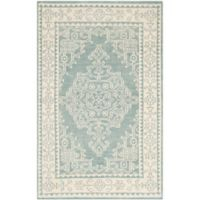 Safavieh Kenya Bordered Floral 4-Foot x 6-Foot Area Rug in Ivory/Blue