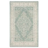 Safavieh Kenya Bordered Floral 5-Foot x 8-Foot Area Rug in Ivory/Blue