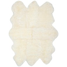 A Safavieh Sheepskin Rug