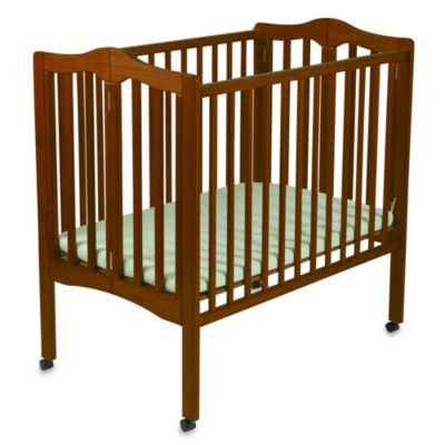 delta portable crib in cherry