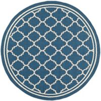 Safavieh Courtyard Quatrefoil 4-Foot Round Indoor/Outdoor Accent Rug in Navy/Beige