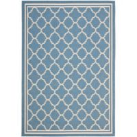 Safavieh Courtyard Quatrefoil 6-Foot 7-Inch x 9-Foot 6-Inch Indoor/Outdoor Area Rug in Blue/Beige