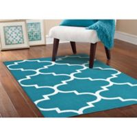 Garland Large Quatrefoil 5-Foot x 7-Foot Area Rug in Teal/White