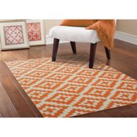 Garland Southwest 5-Foot x 7-Foot Area Rug in Orange/Ivory