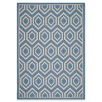 Safavieh Courtyard 6-Foot 7-Inch x 9-Foot 6-Inch Lauryn Indoor/Outdoor Rug in Blue/Beige