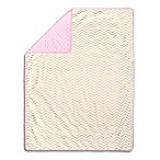 The Peanut Shell® Chevron Pom Pom Blanket in Gold/Pink